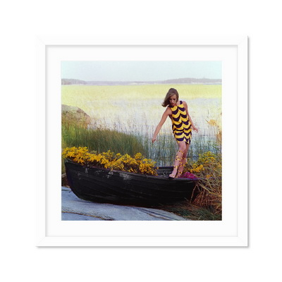 Model In Rowboat Filled With Yellow Flowers Постер